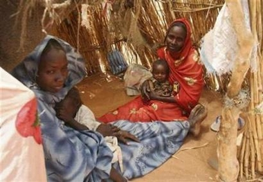 Internally displaced Sudanese women sit inside their make-shift house in their camp near El-Fasher, capital of the north Darfur region, Sudan March 25, 2007  Photo: Michael Kamber/Reuters