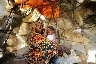A displaced Sudanese woman sits with her daughter in their barrack at the Sakali Displaced Persons camp in Darfur city of Nyala, February 2007.  Picture: AFP/Mustafa Ozer